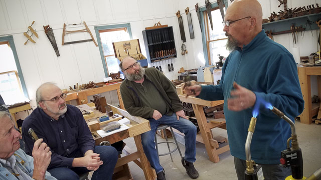 Woodworking students restoring wooden handplanes with Bill Anderson at the Wood and Shop Traditional Woodworking School