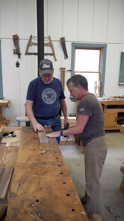 Woodworking students building a Moravian angled dovetail foot stool with David Ray Pine using hand tools at the Wood and Shop Traditional Woodworking School
