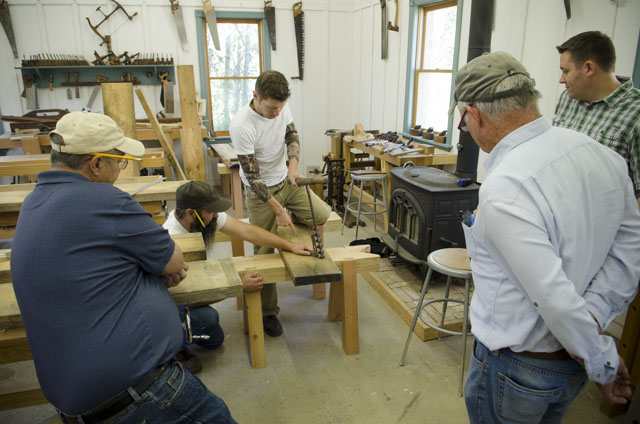 Woodworking students building a green woodworking shaving horse with Ervin Ellis and Willie Ellis at the Wood and Shop Traditional Woodworking School