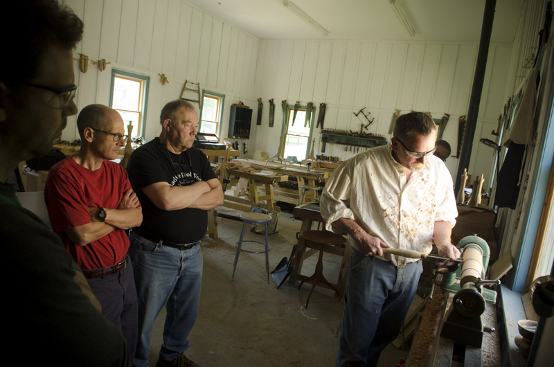 Will Myers demonstrating woodturning to students at Joshua Farnsworth's Wood And Shop Traditional Woodworking School