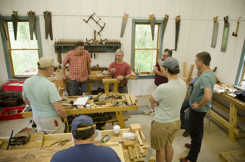 Tom Calisto instructing students on how to sharpen a hand saw at Joshua Farnsworth's Wood And Shop Traditional Woodworking School