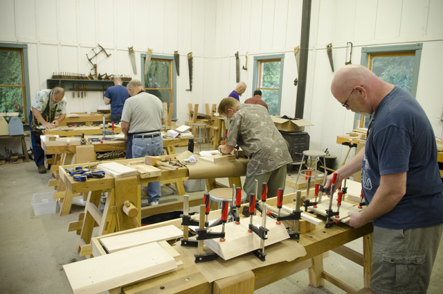Woodworking students working on workbenches at the Wood and Shop Traditional Woodworking School