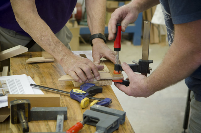 Woodworking students gluing up a wooden try square