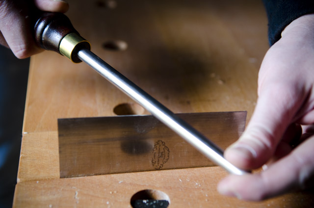 Sharpening a card scraper with a burnishing tool