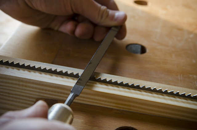 sharpen a hand saw with a rectangular file