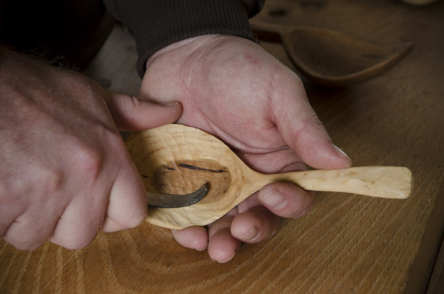 Spoon carving with a hook knife