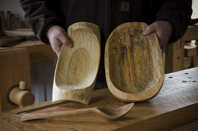 two carved wooden bowls and wooden spoon at the wood and shop traditional woodworking school