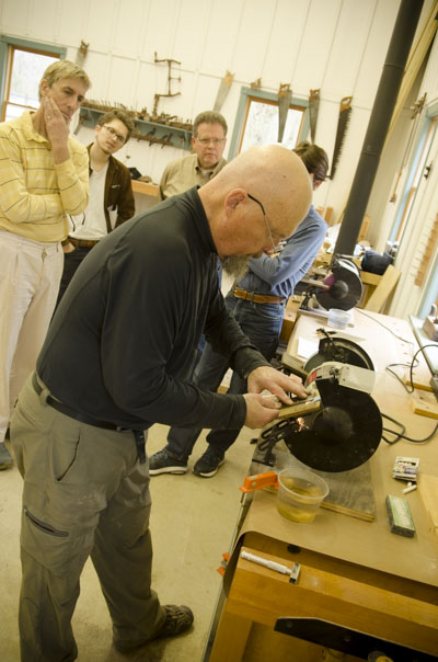 Bill Anderson grinding a handplane iron in a hand tool woodworking sharpening class at the wood and shop traditional woodworking school in Virginia