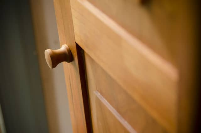 turned knob of a Cherry shaker wall cupboard