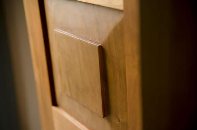 raised panel door of a Cherry shaker wall cupboard