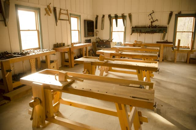 A row of Portable Moravian Workbenches in the Wood and Shop Traditional Woodworking School